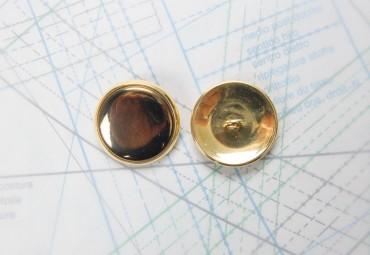 Bouton en métal doré estampé boucle oméga