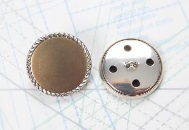 Bouton en métal argenté et doré estampé boucle oméga