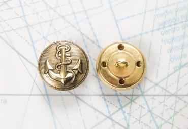 Bouton en métal doré noirci estampé boucle en U insérée