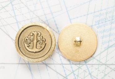 Bouton en métal doré moulé  boucle soudée